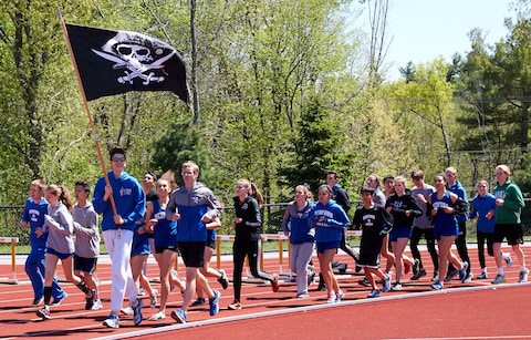 Bedford Track team carrying swag flag